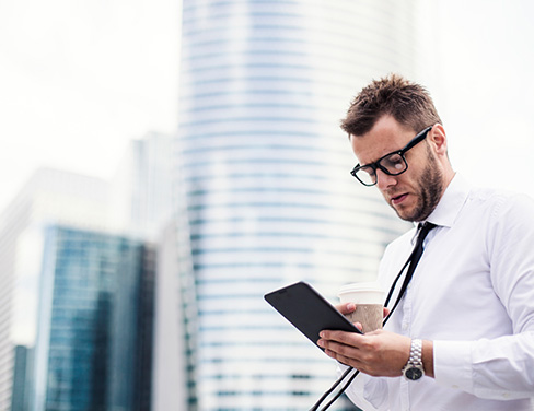 Businessman using tablet device.