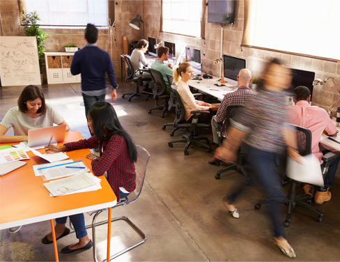 Open office space with workers at computers