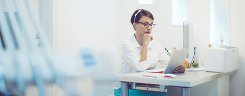 gi-sol-hub-ediscovery-woman-at-desk-on-tablet