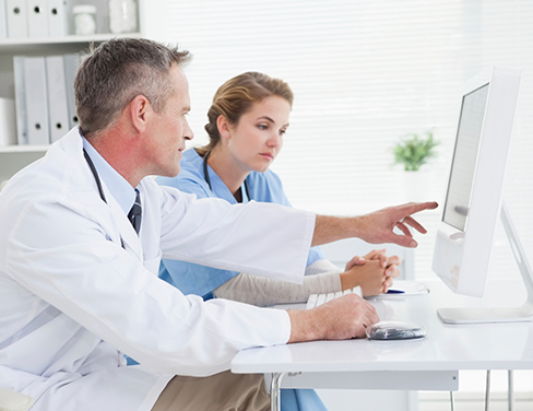 Two-doctors-at-computer-training
