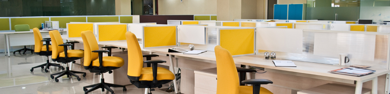 Cubicles with yellow chairs